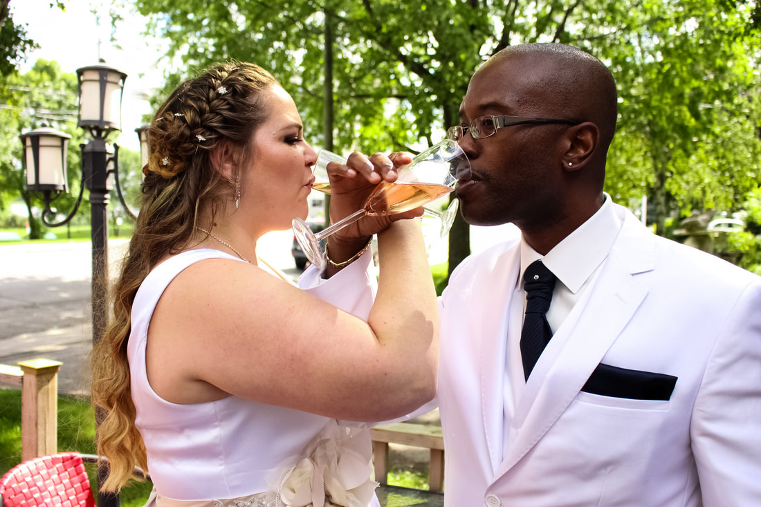 Married people exchanging their glasses