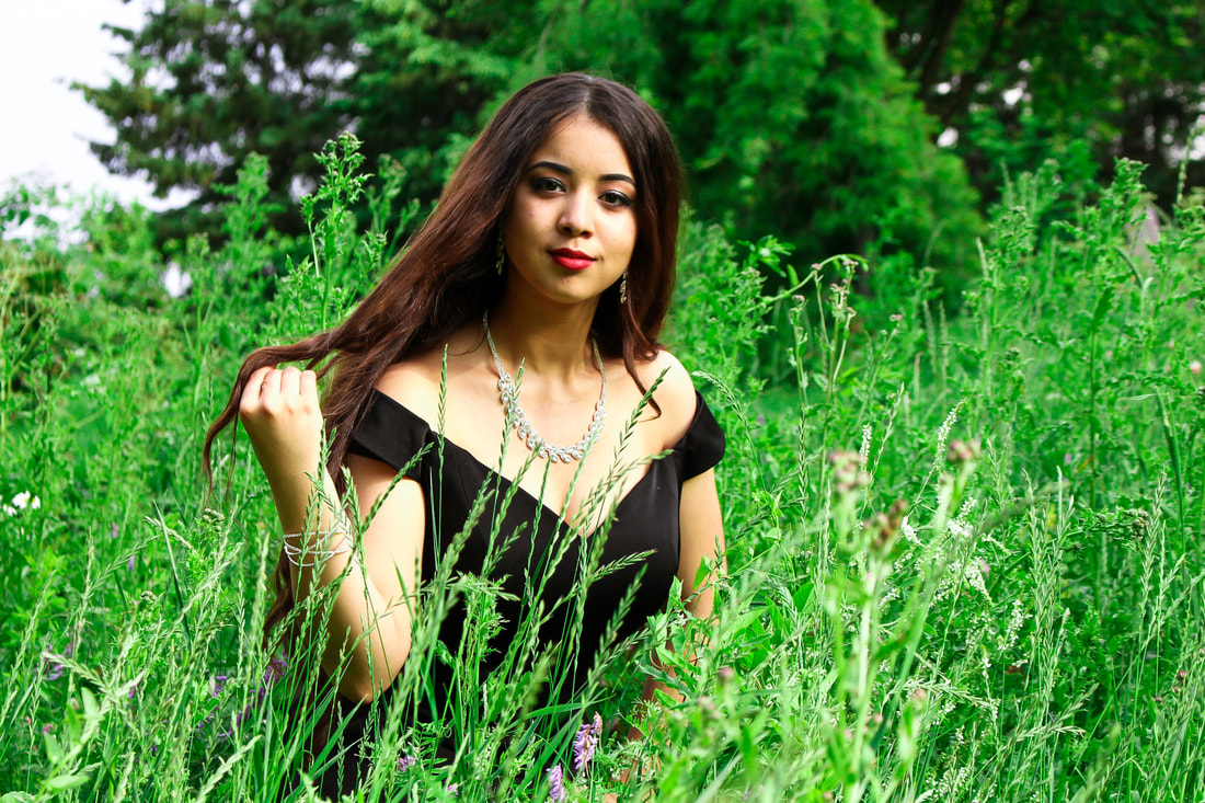 Woman in black dress in long grass